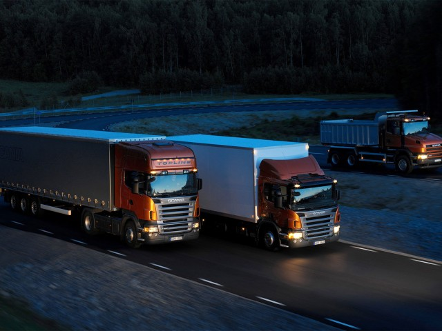 http://cargo.bold-themes.com/transport-company/wp-content/uploads/sites/2/2015/09/Three-orange-Scania-trucks-640x480.jpg